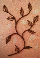 Free-machined on soluble fabric: backing of hand-made paper impressed with leaves and sprayed with Procion dye