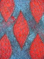 Machine-stitched 'sandwich' of threads and fabrics. Machine cut-work with machine-stitching over voids.